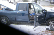 blue truck outside during winter